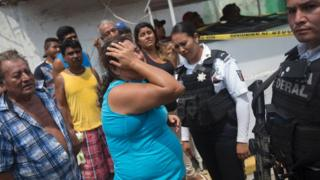 Relatives of five people murdered on a street cry in Acapulco's Icacos neighborhood, Guerrero State, Mexico, on April 17, 2016.