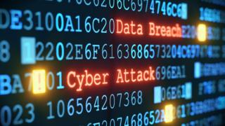 A close-up on an abstract design of a display, which is warning about a cyber attack