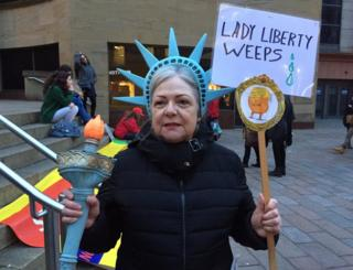 The BBC's Lorna Gordon says this lady from Georgia says she's angry and ashamed about the President's travel ban.