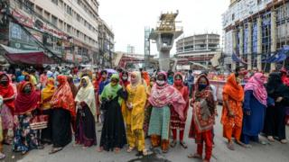 Workers from the garment sector block a road as they protest to demand the payment of due wages during a government-imposed nationwide lockdown as a preventive measure against the Covid-19 in Dhaka on 22 April 22 2020