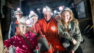 Former miner and visitors underground