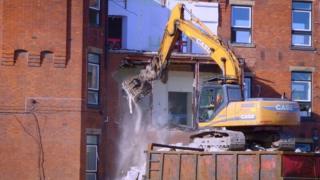 Demolishing the hospital
