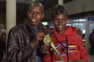 Kenya's Paul Lonyangata and wife Purity Rionoripo pose on Monday in Nairobi with one the gold medals they won at the Paris marathon. Photo/AFP