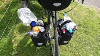 Bike panniers filled with litter