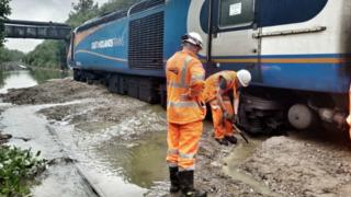 Workmen at site of stranded train