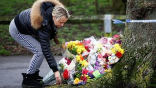 People lay floral tributes near to where 17-year-old Jodie Chesney was killed.
