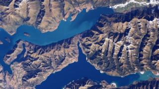 Lake Hāwea below with Lake Wanaka above located in the Otago Lakes area of the South Island.