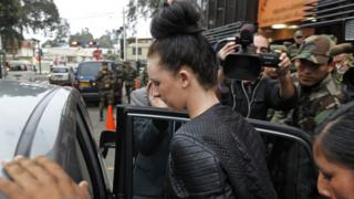 Michaella McCollum is escorted in handcuffs into a car by police in Peru in August 2013