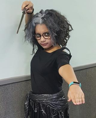 Ten-year-old Aliyah, from Staffordshire, is dressed as Bellatrix Lestrange from Harry Potter with a homemade wand!