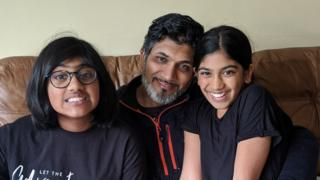 Anand Punja and his daughters