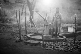Angeline Macamo next to a water pump