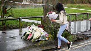 People lay floral tributes near to where 17-year-old Jodie Chesney was killed