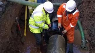 Welsh Water engineers fixing the burst mains