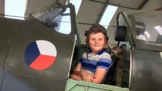 Boy in cockpit