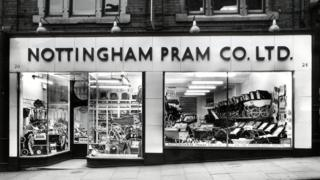 Picture of the shop window of the Nottingham Pram Company