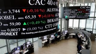 Traders work at the French stock exchange in La Defense, near Paris