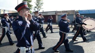 Parade passes Ardoyne shops 2017