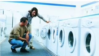 couple buying a washing machine
