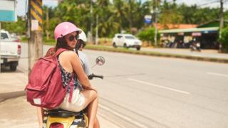 Woman and man on moped