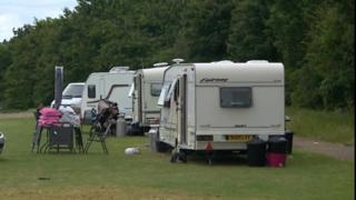 Caravans in a field