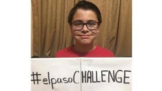 Reuben Martinez holding a sign saying elpasoCHALLENGE