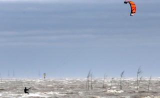 in_pictures A kite surfer on the Weser river in Bremerhaven, northern Germany, 9 February 2020
