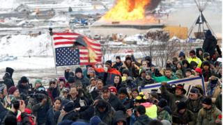 Opponents of the Dakota Access oil pipeline march out of their main camp near Cannon Ball, North Dakota