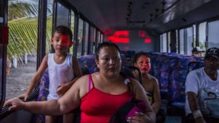 People in Mexico on evacuation buses