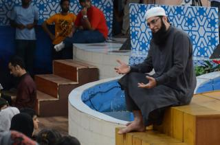 In this photograph taken on August 1, 2013, Pakistani television show host Junaid Jamshed (R) presents an Islamic quiz show Shan-e-Ramadan in Karachi.