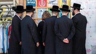 Ultra-Orthodox Jews at a market in Jerusalem in December 2019