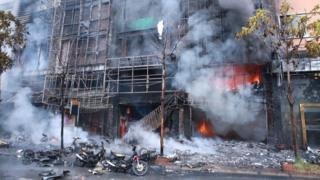 General view from the street after a fire broke out at a karaoke bar in Hanoi, Vietnam, 01 November 2016