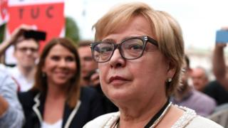 Polish Supreme Court Justice Malgorzata Gersdorf attends a demonstration in support of Supreme Court judges in front of The Supreme Court in Warsaw