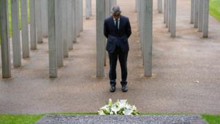 London Mayor Sadiq Khan lays a wreath at the 7 July memorial