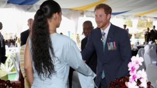 Popstar Rihanna shaking hands with Prince Harry