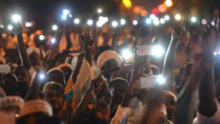 Demonstrators in Sudan with mobile phones at night - May 2019