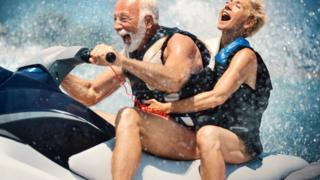 Older man with slightly younger woman on a jet ski