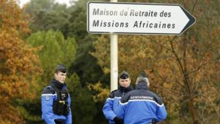 Police stand guard along a security area near a retirement home for Catholic missionaries in Montferrier-sur-Lez