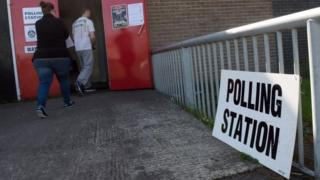 Voters arrive at a polling station in Greater Manchester