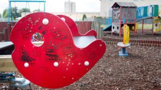 Children's play area covered in graffiti