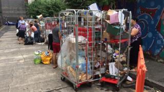 People grabbing leftover food