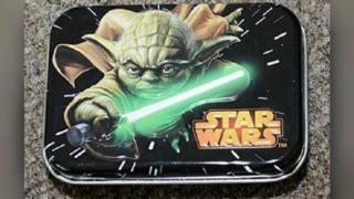 Tin depicting Star Wars character Yoda