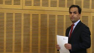 King Juan Carlos University president Javier Ramos preparing to speak to the media