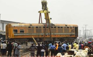Crane lifts a railway carriage back onto tracks in Lagos, Nigeria - Thursday 10 January 2019