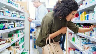 Woman selling in pharmacy