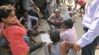 People inside the Tahirpur colony