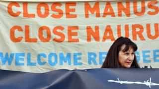 A woman protests against Australia's offshore detention centres for asylum seekers