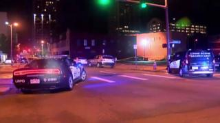 Police vehicles are seen at the scene of the shooting overnight