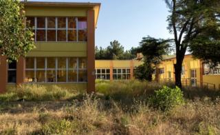 "One of the two schools shut down due to the high level of pollutants on the ""ecological hills"" that were built between the schools and the plant"