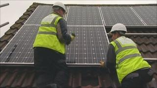 Installing solar panels on a roof