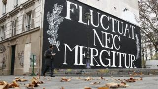 """City of Paris motto """"Fluctuat Nec Mergitur"""", Latin for """"buffeted (by waves) but not sunk"""", in Paris, France, November 17, 2015"""
